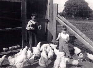 Mason (right) and his brother with the family's chickens